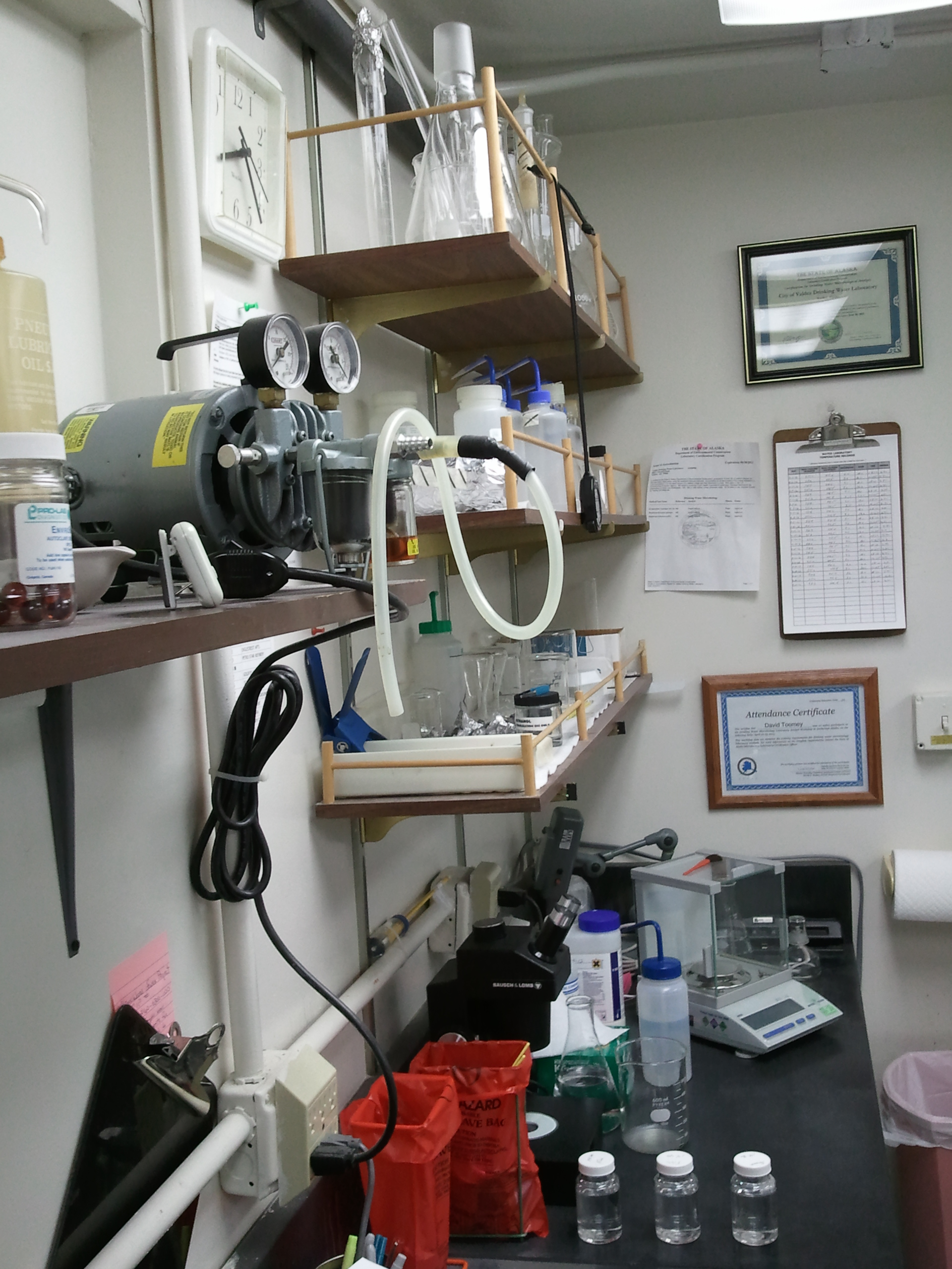 pic of a lab bench and shelves with associated equipment